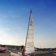 Tweendeck (catamaran) with sail on the beach