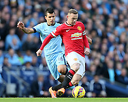 Manchester City's Sergio Aguero hustles Manchester United's Wayne Rooney - Barclays Premier League - Manchester City vs Manchester Utd - Etihad Stadium - Manchester - England - 2nd November 2014  - Picture David Klein/Sportimage