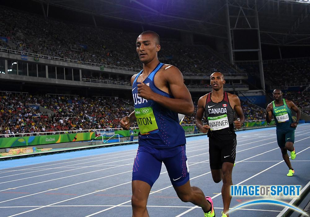 Aug 18, 2016; Rio de Janeiro, Brazil; Ashton Eaton (USA) runs 4:23.33 in the decathlon 1,500m during the 2016 Rio Olympics at Estadio Olimpico Joao Havelange. Eaton tied the Olympic record to win with 8,893 points.