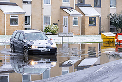 © Licensed to London News Pictures 28/12/2020, Cirencester, UK. Parts of cirencester already flooded by recent heavy rain now contend with fresh snowfall as well. Photo Credit : Stephen Shepherd/LNP