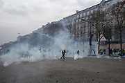 December, 8th, 2018 - Paris, Ile-de-France, France: Tear gas on Champs Elysees. The French 'Gilets Jaunes' demonstrate a fourth day. Their movement was born against French President Macron's high fuel increases. They have been joined en mass by students and trade unionists unhappy with Macron's policies. Nigel Dickinson