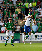 Photo: Andrew Unwin.<br />Northern Ireland v Azerbaijan. FIFA World Cup Qualifying match. 03/09/2005.<br />Northern Ireland's Tony Capaldi (#3) rises above Azerbaijan's Zaur Tagizade (#20).