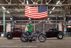 Dave Turner with his custom1976 Shovelhead (in a '47 frame) and a 1932 Ford (left) and 1930 Ford Hotrods on setup day for the Congregation Show in Charlotte, NC. USA. Friday April 13, 2018. Photography ©2018 Michael Lichter.