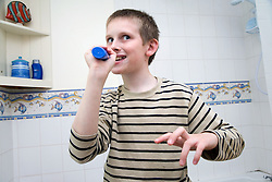 Boy with Autism cleaning his teeth,