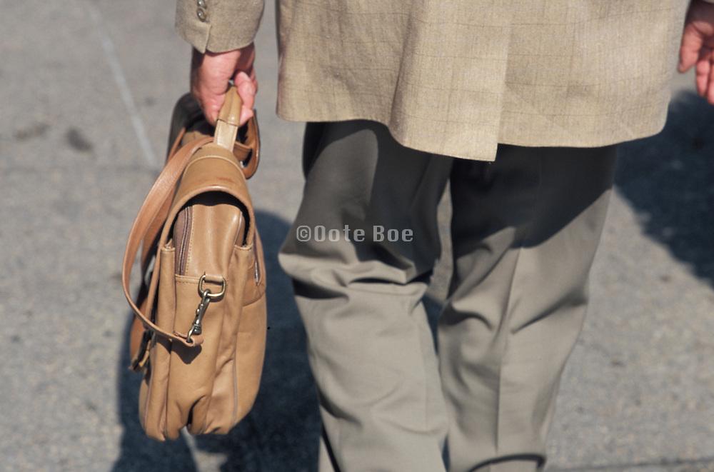 close-up of businessman walking