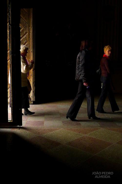 Women entering a Catholin church in Vilnius