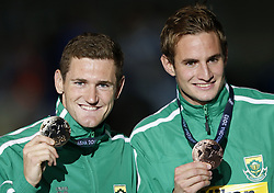 BARCELONA, Aug. 1, 2013  Cameron van der Burgh (L) of South Africa shows his gold medal as his compatriot Giulio Zorzi shows his bronze medal after the awarding ceremony for men's 50m breaststroke final of the Swimming competition of the 15th FINA World Championships at Palau Sant Jordi in Barcelona, Spain on July 31, 2013. Cameron van der Burgh claimed the title with 26.77 seconds. (Xinhua/Wang Lili) (Credit Image: © Xinhua via ZUMA Wire)