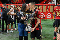 December 8, 2018 - Atlanta, GA, U.S. - ATLANTA, GA Ð DECEMBER 08:  Atlanta United's Miguel Almiron (10) holds the MLS Cup trophy while kissing his wife during the post-game celebration following the conclusion of the MLS Cup between the Portland Timbers and Atlanta United FC on December 8th, 2018 at Mercedes-Benz Stadium in Atlanta, GA.  (Photo by Rich von Biberstein/Icon Sportswire) (Credit Image: © Rich Von Biberstein/Icon SMI via ZUMA Press)