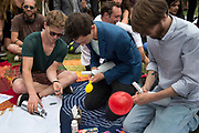 London August 1st 2015 Nitrous Oxide Parliament Square, protest against the proposed Psychoactive Substances Bill. Filling balloons with nitrous oxide.