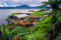 Indonesia, Sulawesi, Tondano. Lake Tondano is a large lake along the side of an ancient volcanic caldera. These houses are built on stilts above the water.
