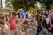"""20 AUGUST 2020 - DES MOINES, IOWA: Members of the Black Liberation Movement march to a vigil in Des Moines for missing Black children. About 150 people, members of and supporters of Des Moines Black Liberation Movement (which used to be known as Black Lives Matter) marched through a residential neighborhood of Des Moines Thursday night demanding justice for Black children. The march was called to show support for Breasia Terrell and  Abdullahi """"Abdi"""" Sharif, two Black children who went missing in Iowa this year. Terrell, a 10 year old girl,  went missing on July 10 and is still missing. Sharif, a teenager, disappeared from a Des Moines shopping mall in January, his body was found in May. Members of BLM said authorities have not adequately investigated the disappearances.      PHOTO BY JACK KURTZ"""