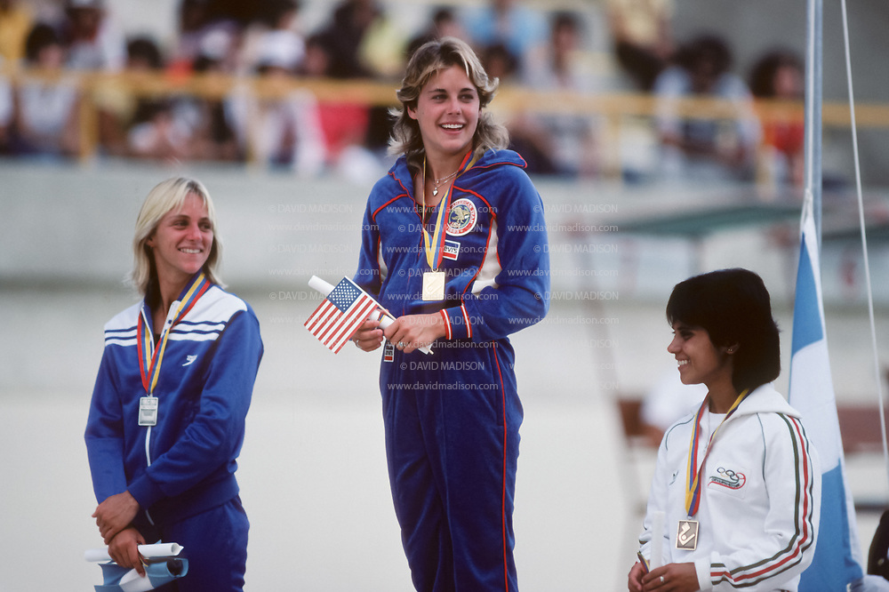 CARACAS, VENEZUELA - AUGUST 1983:  Wendy Wyland of the United States receives her gold medal in the Women's 10 meter platform diving event of 1983 Pan Am Games in Caracas, Venezuela; at left is silver medalist Veronica Ribot-Canales of Argentina, at right is bronze medalist Guadalupe Canseco of Mexico..  (Photo by David Madison/Getty Images)