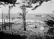 """Ackroyd 05295-07. """"West Shore Manor.  June 22. 1954. Swimming pool at right. Several hundred yards beyond the surf is a reef of large rocks inhabited by thousands of sea birds and a herd of seals."""" (West Shore Manor on Otter Rock, about five miles south of Depoe Bay, burned down November 6, 1963)"""