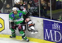 Brendan Yarema vs David Rodman at 39th Round of EBEL League ice hockey match between HDD Tilia Olimpija and Acroni Jesenice, on December 30, 2008, in Arena Tivoli, Ljubljana, Slovenia. Tilia Olimpija won 4:3. (Photo by Vid Ponikvar / SportIda).