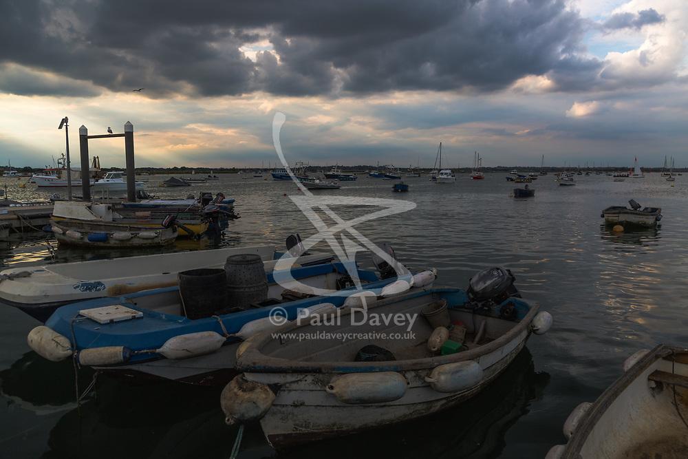 Clouds block the evening sun at West Mersea, Mersea Island, near Colchester in Essex. West Mersea, Essex, July 11 2019.