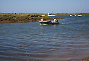 Small boats in the tidal creek at Brancaster Staithe, north Norfolk coast, England
