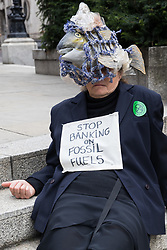 London, UK. 2nd September, 2021. An Extinction Rebellion climate activist protests in front of the Bank of England on the eleventh day of Impossible Rebellion protests. Extinction Rebellion are calling on the UK government to cease all new fossil fuel investment with immediate effect.