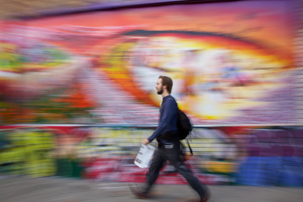 I was participating in a Bryan Peterson workshop in San Francisco and this hipster dude walking past a colorful mural in san francisco was actually taken during the workshop teaching us motion techniques.