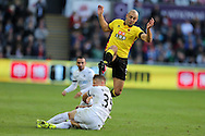 Nordin Amrabat of Watford jumps over the tackle from Stephen Kingsley of Swansea city .Premier league match, Swansea city v Watford at the Liberty Stadium in Swansea, South Wales on Saturday 22nd October 2016.<br /> pic by  Andrew Orchard, Andrew Orchard sports photography.