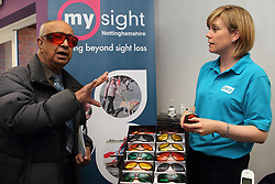 Trying on different shades of glasses at the Mysight charity for people with visual impairments.