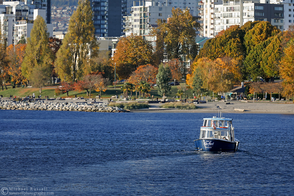 """The False Creek Ferry """"Spirit of False Creek"""" crosses False Creek from Sunset Beach to Granville Island.  Photographed from Granville Island in Vancouver, British Columbia, Canada."""