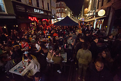 © Licensed to London News Pictures.  17/04/2021. London, UK. Members of the public making the most of Saturday night out in Soho, central London. Earlier this week Lockdown restrictions were eased to allow non essential retail and outdoor dining to reopen. Photo credit: Marcin Nowak/LNP