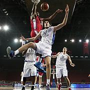 Anadolu Efes's Okben Ulubay (F) during their Turkish Basketball League match Anadolu Efes between Tofas at the Abdi ipekci Arena in Istanbul, Turkey on Tuesday, 24 December, 2013. Photo by TURKPIX