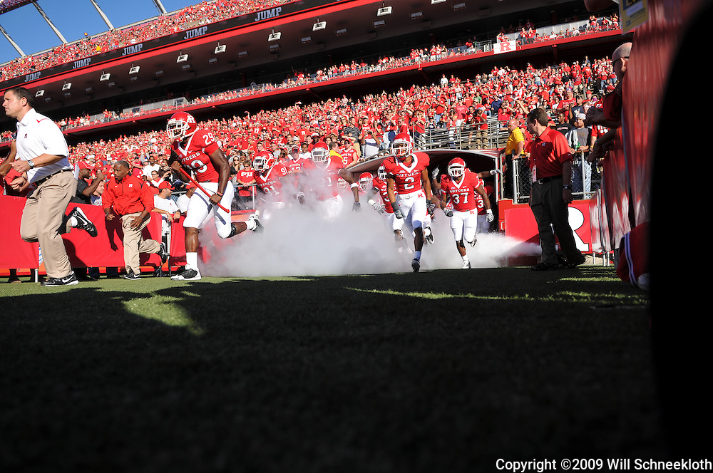 Sep 19, 2009; Piscataway, NJ, USA; Rutgers head coach Greg Schiano leads his team onto the field for the first half of NCAA college football between Rutgers and Florida International at Rutgers Stadium.