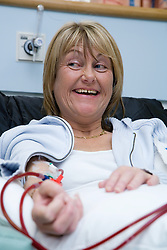 Woman undergoing dialysis on the Nottingham City Hospital Renal Unit,