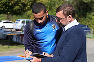 AFC Wimbledon defender Rod McDonald (26) signing autographs during the EFL Sky Bet League 1 match between AFC Wimbledon and Oxford United at the Cherry Red Records Stadium, Kingston, England on 29 September 2018.