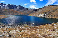 The pristine waters of Summit Lake nestled below the Mount Evans peak in the Rocky Mountains of Colorado, USA