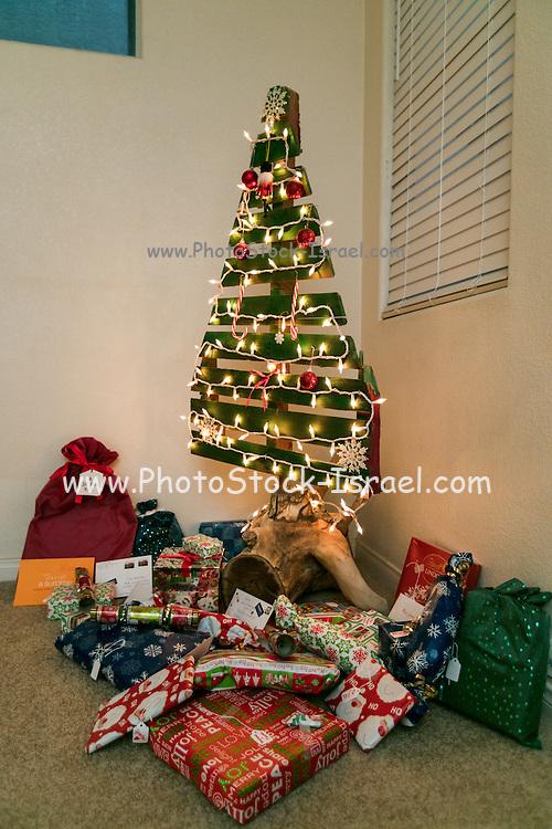 Christmas presents under an ecological, reusable Christmas tree