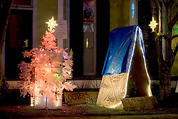 21st, December 2005. New Orleans Christmas decorations. Uptown, Penniston Street. A humerous refrigerator Christmas tree complete with a makeshift 'FEMA' trailer, a blue tarp roof and rescue graffiti. Refrigerators litter the city following Hurricane Katrina where food sat rotting for weeks and months with no power, here a resident tries to inject a little humour into the season.
