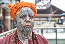 © licensed to London News Pictures. 26/09/2014<br /> The 10th London International Tattoo Convention, one of the most prestigious body art conventions in the world, brought together 400 of the best tattoo artists to thousands of admirers at Tobacco Dock. Other attractions and alternative performances included burlesque, sword swallowing, striptease dancers, fire-dancers and trapeze performers. Pictured. Artist Lestyn Flye from London.<br /> Photo credit : Ian Whittaker/LNP