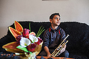 Boy rehearsing at home with the trumpet in the city of Delcevo, Macedonia.