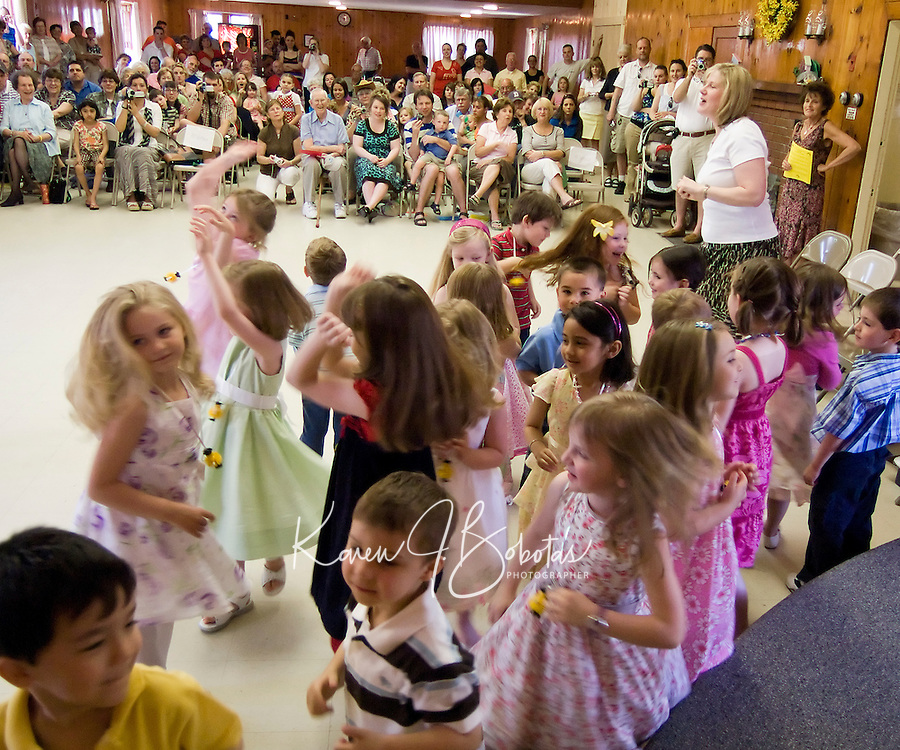 Jack and Jill Nursery School students along with their teacher Ms. Julie Wirth dance and perform for a packed house at Leavitt Park Friday morning during their 2009 Graduation ceremony.  (Karen Bobotas/for the Laconia Daily Sun)