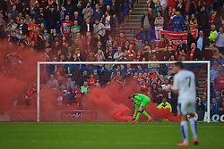 BIRKENHEAD, ENGLAND - Friday, July 8, 2016: Liverpool's goalkeeper Adam Bogdan picks up a red smoke bomb during a preseason friendly match against Tranmere Rovers at Prenton Park. (Pic by Bradley Ormesher/Propaganda)