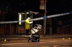 © Licensed to London News Pictures. 14/01/2019. Anerley, UK. Pushchair in the road with a wheel to the left, A mother has been killed and a child is in hosptial fighting for life after being hit by a car crossing the road in Anerley near Penge.<br />   Photo credit: Grant Falvey/LNP