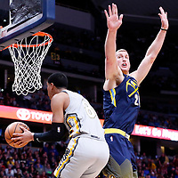 07 March 2018: Cleveland Cavaliers guard Jordan Clarkson (8) goes for the reverse layup past Denver Nuggets center Mason Plumlee (24) during the Cleveland Cavaliers 113-108 victory over the Denver Nuggets, at the Pepsi Center, Denver, Colorado, USA.