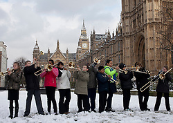 © Licensed to London News Pictures.21_01_2013 LONDON UK.Children various schools from Newham East London, warm up their instruments outside the Palace of Westminster before performing at a House of Lords reception. Photo credit : Andrew Baker/LNP