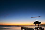 Mauritius Island. Mauritius Island. Hut with boardwalk at sunset at Hilton Hotel