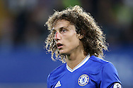 David Luiz of Chelsea looks on with a bloodied nose. Premier league match, Chelsea v Liverpool at Stamford Bridge in London on Friday 16th September 2016.<br /> pic by John Patrick Fletcher, Andrew Orchard sports photography.