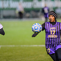 Socorro Warrior Claire Edmondson (17), left, and Kirtland Central Bronco Nikki Begay (17)  chase a ball during a quarterfinal match in the state soccer tournament at the Albuquerque Public Schools soccer complex in Albuquerque Thursday.