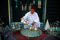 """Moroccan man serving mint tea at the """"Al Fassia"""" restaurant in the Palais Jamai, Fes, Morocco"""