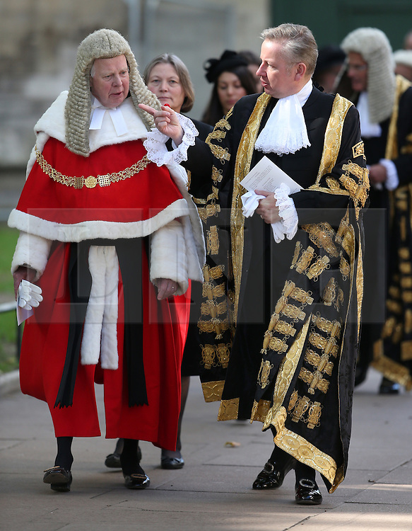 © Licensed to London News Pictures. 01/10/2015. London, UK. The Lord Chancellor and Secretary of State for Justice MICHAEL GOVE (R) gestures to The Lord Chief Justice Baron Thomas of Cwmgiedd as they take part in the annual Judges Service at Westminster Abbey. The Service heralds the start of the legal year in the United Kingdom. Photo credit: Peter Macdiarmid/LNP