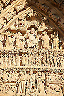 Tympanum of central west portal: Christ in Majesty presides over the Day of Judgement, supported by an array of saints.  Gothic Cathedral of Notre-Dame, Amiens, France . The Cathedral Basilica of Our Lady of Amiens or simply Amiens Cathedral, is a Roman Catholic  cathedral the seat of the Bishop of Amiens. It is situated on a slight ridge overlooking the River Somme in Amiens. Amiens Cathedral, was built almost entirely between 1220 and c.1270, a remarkably short period of time for a Gothic cathedral, giving it an unusual unity of style. Amiens is a classic example of the High Gothic style of Gothic architecture. It also has some features of the later Rayonnant style in the enlarged high windows of the choir, added in the mid-1250s. Amiens Cathedra has been listed as a UNESCO World Heritage Site since 1981. Photos can be downloaded as Royalty Free photos or bought as photo art prints. <br /> <br /> Visit our MEDIEVAL PHOTO COLLECTIONS for more   photos  to download or buy as prints https://funkystock.photoshelter.com/gallery-collection/Medieval-Middle-Ages-Historic-Places-Arcaeological-Sites-Pictures-Images-of/C0000B5ZA54_WD0s