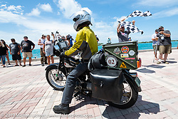 Brian Pease riding his 1938 Nimbus C (in a 52 frame) over the finish line at the end of the Cross Country Chase motorcycle endurance run from Sault Sainte Marie, MI to Key West, FL. (for vintage bikes from 1930-1948). The Grand Finish in Key West's Mallory Square after the 110 mile Stage-10 ride from Miami to Key West, FL and after covering 2,368 miles of the Cross Country Chase. Sunday, September 15, 2019. Photography ©2019 Michael Lichter.