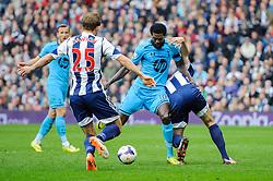 Emmanuel Adebayor (TOG) of Tottenham Hotspur is challenged by Craig Dawson (ENG) of West Brom - Photo mandatory by-line: Rogan Thomson/JMP - 07966 386802 - 12/04/2014 - SPORT - FOOTBALL - The Hawthorns Stadium - West Bromwich Albion v Tottenham Hotspur - Barclays Premier League.