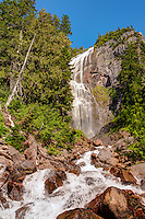 Spray Falls is a 300' cascading waterfall located near the north face of Mount Rainier at 5000' in elevation.