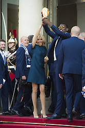 French President Emmanuel Macron's wife Brigitte Macron holds the trophy next to France's midfielder Paul Pogba during a reception at the Elysee Presidential Palace on July 16, 2018 in Paris, France, after French players won the Russia 2018 World Cup final football match. France celebrated their second World Cup win 20 years after their maiden triumph on July 15, 2018, overcoming a passionate Croatia side 4-2 in one of the most gripping finals in recent history. Photo by Eliot Blondet/ABACAPRESS.COM